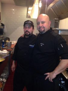 Chef Jason Carron in the restaurant kitchen with other cook