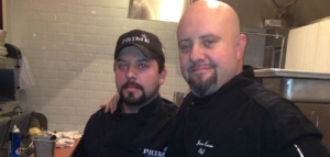 Chef Jason Carron training restaurant kitchen staff