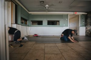 Construction workers renovating floor at Guilford Mooring restaurant, CT