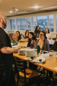 Jason Carron at Avery Restaurant Consulting training introducing a new menu before the grand reopening