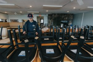 A man moving new furniture at Guilford Mooring Restaurant, CT
