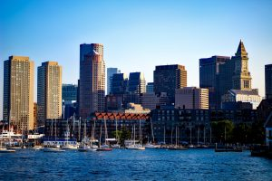 Downtown Boston view from the water, overlooking historic North End and Financial District, where Jason Carron operates