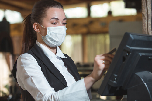 waitress wearing a protective mask