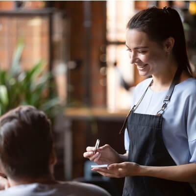 waitress taking customer order
